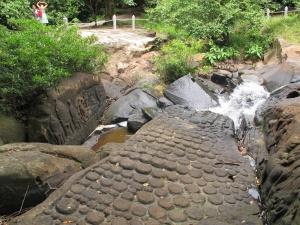 Lingas and Hindu gods on rocks