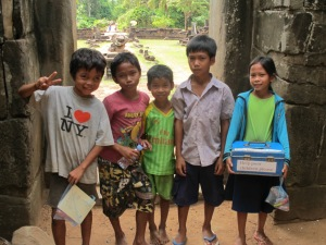 Khmer children at entrance of Bakong Temple tower