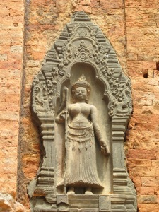 Devata on temple wall niche, Bakong Temple