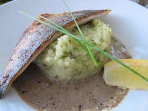 Grilled fish with tapenade sauce and herbed mashed potatoes