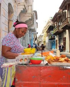 Snack vendor under hotel balcony