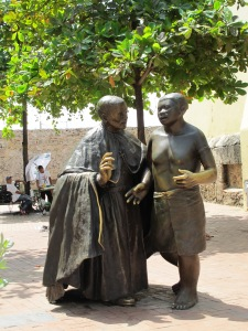 Statue of San Pedro Claver with a slave